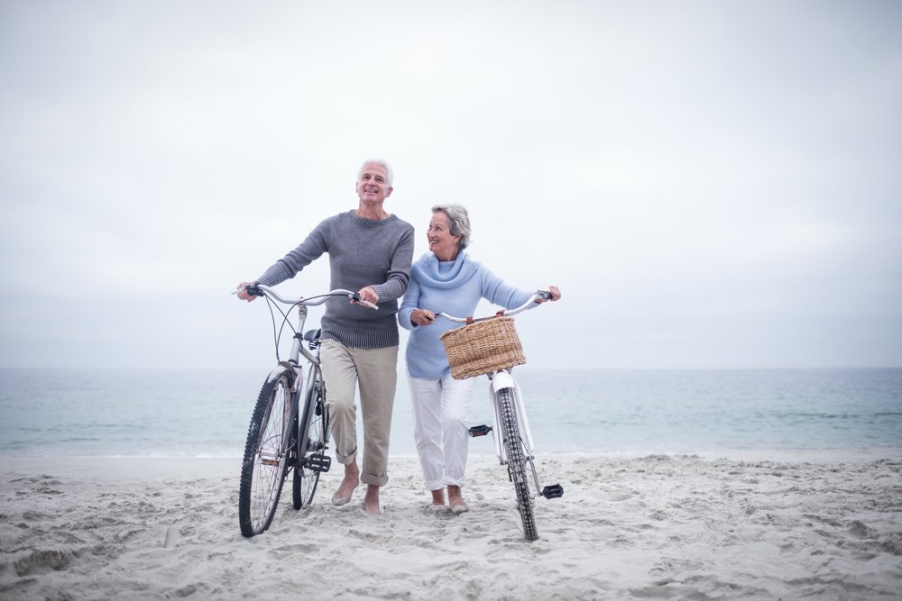 retired couple cycling